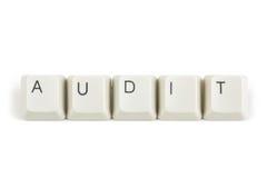Audit from scattered keyboard keys on white Stock Image