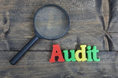 Audit on wooden table Royalty Free Stock Photos