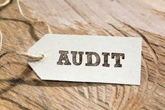 Audit. Word written on a Looking card stock photo