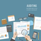 Auditing concepts. Auditor inspects financial documents. Accounting, analysis, analytics. Businessman hands with magnifying glass. Above documents, graphics Royalty Free Stock Images