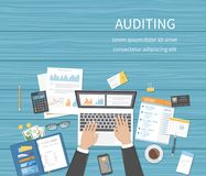 Auditing concepts. Businessman auditor inspects assessing financial documents. Man`s hands with laptop, documents, forms. Research. Management, analysis, data Stock Images