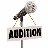 Audition Sign Hanging from Microphone Try-Outs Performance. Audition word on a sign hanging from a microphone as an invitation to try out or perform for a Stock Photography