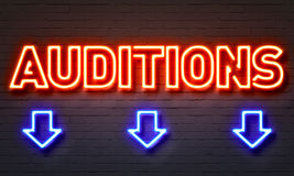 Auditions neon sign. On brick wall background Royalty Free Stock Photos