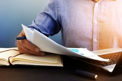 Auditor checking financial report. Paperwork in the office and audit. Stock Photos