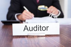 Auditor looking at document Stock Image