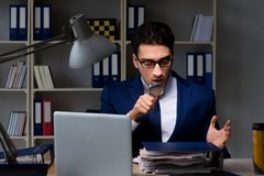The auditor looking for errors in financial reporting for company. Auditor looking for errors in financial reporting for company Stock Photos