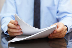 Auditor is reading documentation. Auditor is reading paper documentation stock photography