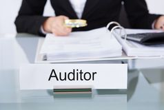 Auditor scrutinizing financial documents Royalty Free Stock Photos