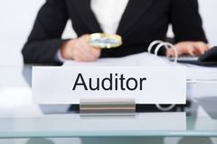 Auditor Scrutinizing Financial Documents Stock Photos