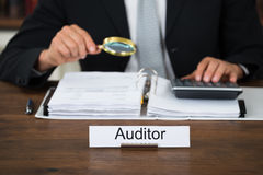 Auditor Scrutinizing Financial Documents In Office Stock Photography
