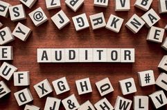 Auditor word concept on cubes stock photos