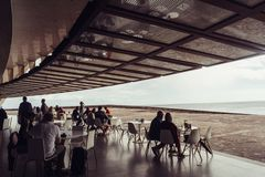Auditorio de Tenerife, Santa Cruz de Tenerife, Espania - October 26, 2018: Some people are sitting in the Cafe from the Auditorio royalty free stock photography