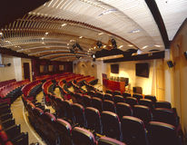 Auditorium. Interior view of large auditorium from underneat the balcony royalty free stock image
