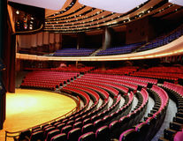 Auditorium. Interior view of large auditorium from underneat the balcony royalty free stock photo