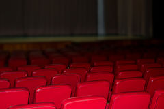 Auditorium with chairs red Stock Photography