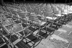 Auditorium full of shiny metal chairs Royalty Free Stock Photography