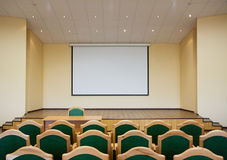 Auditorium hall with projection screen. Modern auditorium hall for presentation with projection screen Stock Image