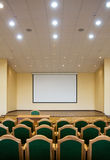 Auditorium hall with projection screen Stock Images