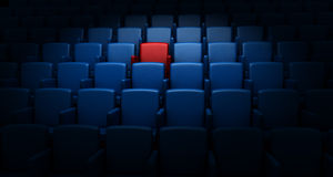 Auditorium with one reserved seat Royalty Free Stock Photos