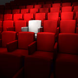The auditorium with one white seat. The auditorium with one reserved seat Royalty Free Stock Images