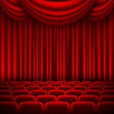 An auditorium with a red curtain Stock Photography