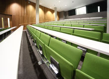 Auditorium with rows of seats and tables Stock Photography