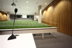 Auditorium with rows of seats and tables Royalty Free Stock Images