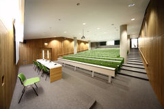 Auditorium with rows of seats and tables Royalty Free Stock Photography