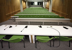 Auditorium with rows of seats and tables stock photo