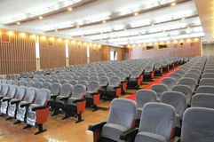 The auditorium with seats. The auditorium of a theater with files of seats stock photo