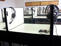 Auditory classroom. The interior of a classroom with listening booths and headphones Royalty Free Stock Images