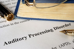 Auditory processing disorder APD. Auditory processing disorder APD on a sheet on an office table stock photography