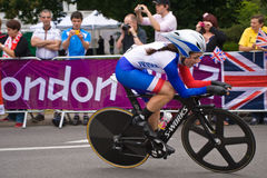 Audrey Cordon in the Olympic Time Trial. French Cyclist Audrey Cordon on the road in Surrey during the London 2012 Olympic Cycling Time Trial Royalty Free Stock Photography