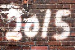 2015 auf Backsteinmauer Stockfotos
