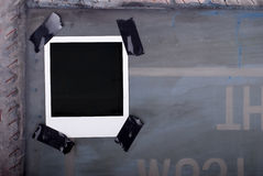 Auf Band aufgenommenes Polaroid Lizenzfreies Stockbild