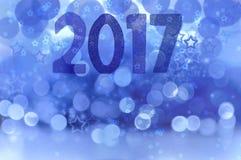 2017 auf blauem Hintergrund Stockbild
