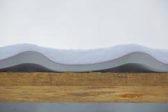 Auf dem Dach der Schnee Stockbild