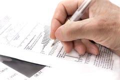 Auf dem Hintergrund der Finanzdokumente Stockbild