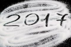 2017 auf dem Hintergrund vom Zucker Stockbild