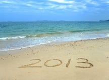 2013 auf dem Strand des Sonnenaufgangs Lizenzfreie Stockbilder
