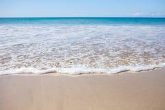 Auf den Strand gesetzte Welle Lizenzfreies Stockfoto