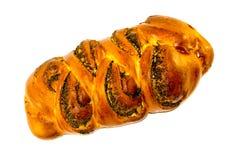Auf einem weißen Hintergrund umsponnenes Brot mit Mohn ausstrahlen Bäckereiprodukte mit Mohn auf weißem lokalisiertem Hintergrund lizenzfreies stockbild