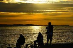 Auf Fischen bei Sonnenuntergang Lizenzfreies Stockbild