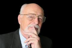Auf lagerfoto des intelligenten älteren Mannes stockbild