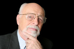 Auf lagerfoto eines skeptischen älteren Mannes Lizenzfreies Stockbild