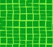 Auf Quadraten eines grünen Hintergrundgrüns Stockbilder