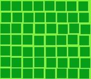 Auf Quadraten eines grünen Hintergrundgrüns Stockfoto
