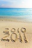 Auf Sand am Ozeanrand wird es 2011 geschrieben Stockbild