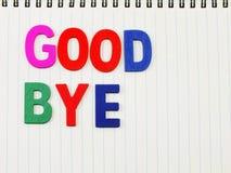 Auf Wiedersehen Alphabet auf Notizbuchpapierhintergrund Lizenzfreie Stockbilder