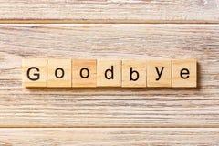 Auf Wiedersehen Wort geschrieben auf hölzernen Block Auf Wiedersehen Text auf Tabelle, Konzept Stockfotografie
